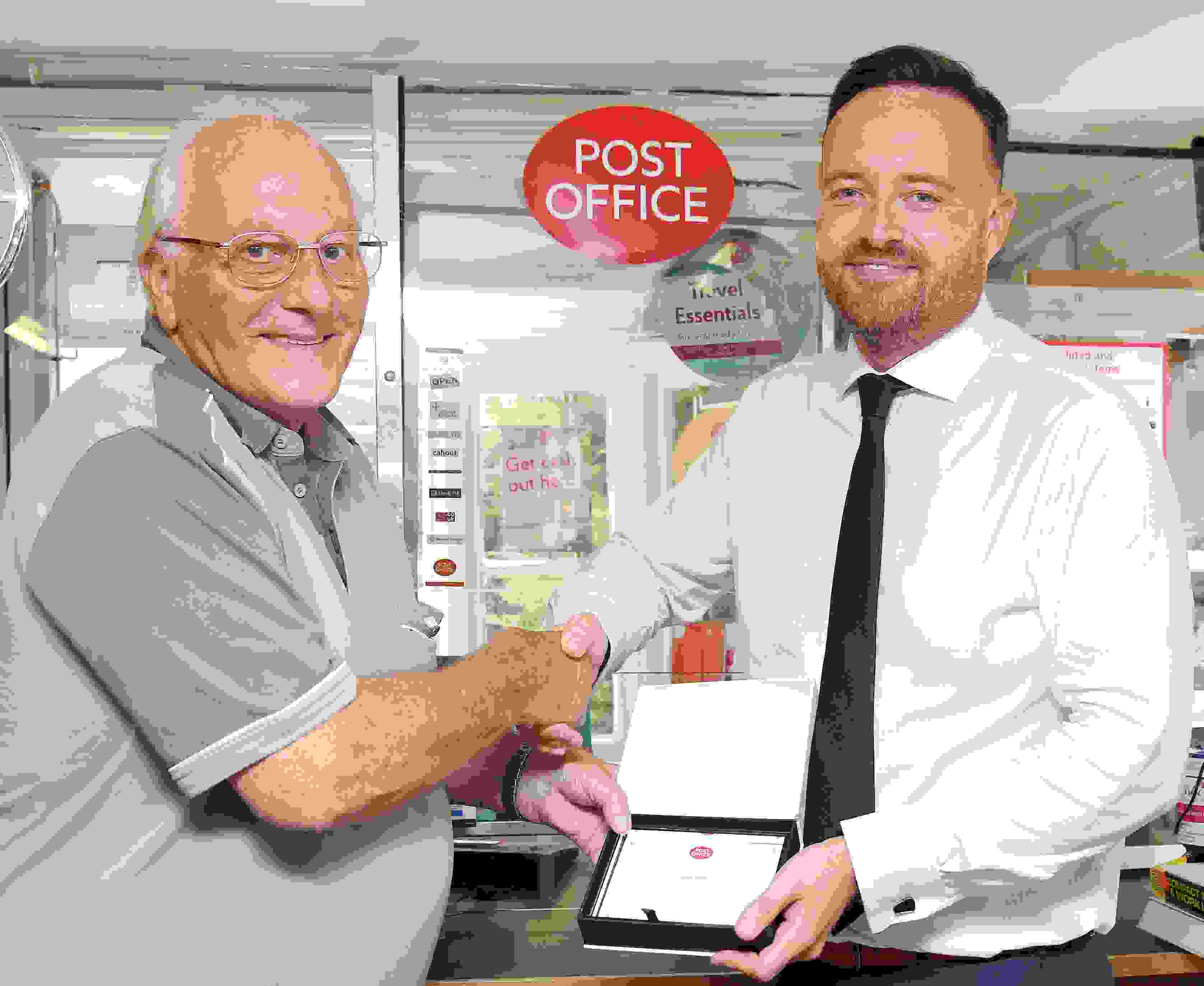 Recognition for Postmaster after 50 years' service